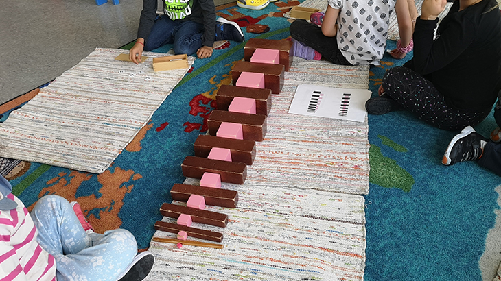 Children use building blocks at school.