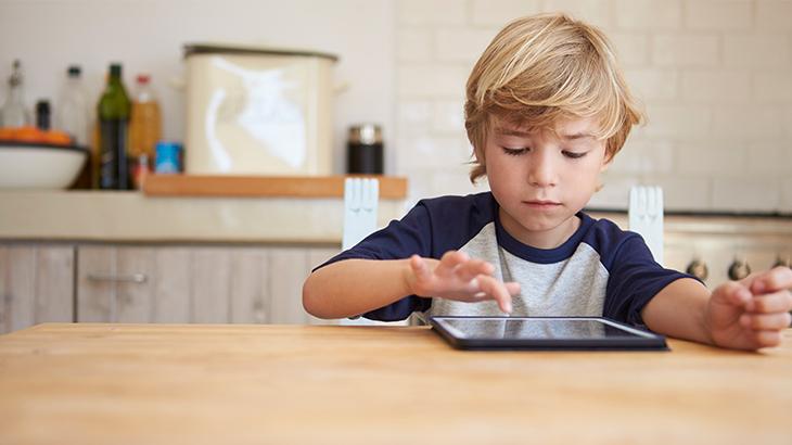 Child using an iPad.