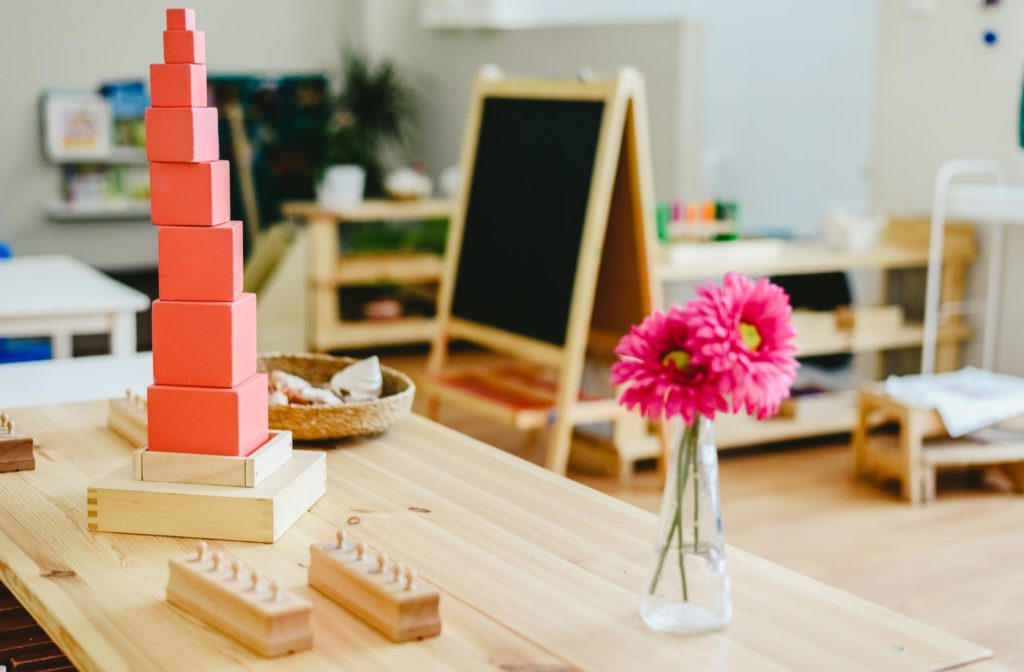 montessori classroom with building blocks and flowers